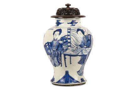 A CHINESE BLUE AND WHITE 'SEAMSTRESSES' VASE. Kangxi. Of baluster form, finely painted in underglaze