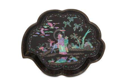 A CHINESE MOTHER-OF-PEARL INLAID BLACK LACQUER TRAY. Kangxi. Shaped in the form of a leaf, the