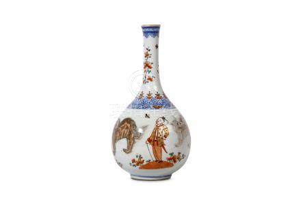 A CLOBBERED CHINESE COPPER RED 'LIONS' VASE. Kangxi. The pear-shaped vase painted in underglaze