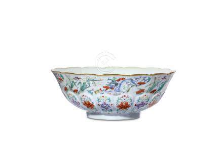 A CHINESE FAMILLE ROSE MOULDED BOWL. Qing Dynasty,