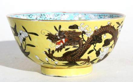A Chinese footed bowl decorated with dragons & flowers on a yellow ground, Guanxu mark & period,