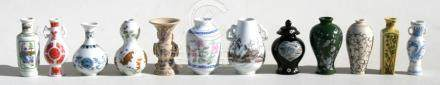 A group of twelve Chinese style miniature vases, each approx. 7.5cms (3ins) high.
