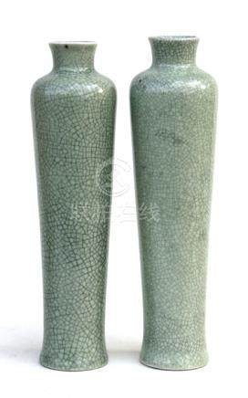 A pair of Chinese celadon crackle glazed vases of cylindrical tapering form, 29cms (11.5ins) high.