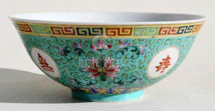 A Chinese famille rose footed bowl decorated with flowers & calligraphy on a turquoise ground, 18.