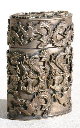 A Chinese silver plated lidded box decorated with applied dragons, 7cms (2.75ins) high.