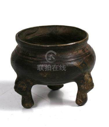 A Chinese pewter censer of globular form, on three lion mask capped legs, 9cms (3.5ins) high, a
