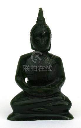 A jade Buddha seated in meditation, 8cms (3.1ins) high. ??est