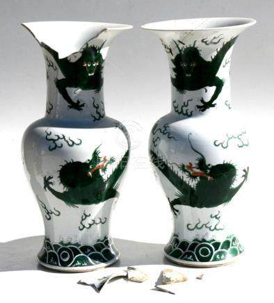 A pair of 19th century Chinese famille verte vases decorated with dragons chasing a flaming pearl,