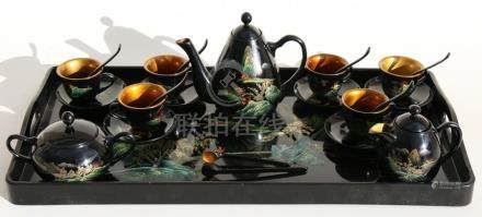 A Chinese lacquer tea set.