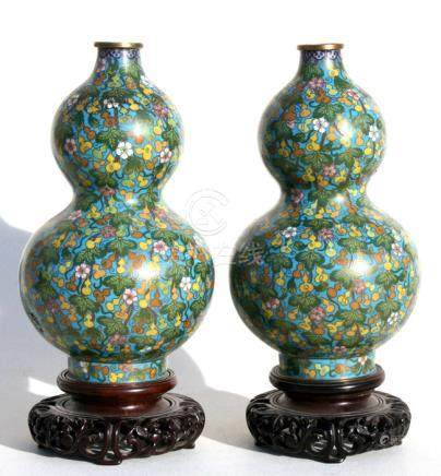A pair of Chinese cloisonne double gourd vases decorated with fruit and flowers on a turquoise
