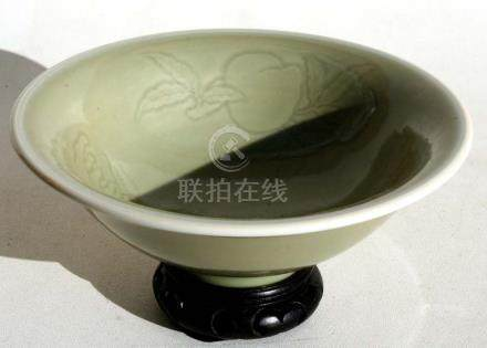 A Chinese celadon glazed bowl on stand decorated with fruit & flowers, 20cms (8ins) diameter.