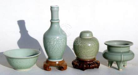 A Chinese celadon glaze bowl on a hardwood stand, 15cms (6ins) diameter; together with a Chinese