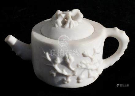 A Chinese carved white soapstone teapot decorated in relief with flowers, 11cms (4.75ins) high.