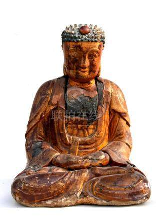 A large Chinese Ming gilt wood buddha seated in meditation, 43cms (17ins) high.