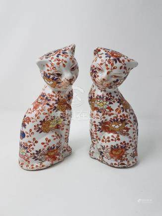 A near pair of Oriental seated cats.