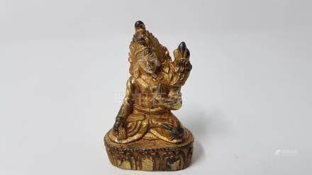 A Tibetan Buddhist gilded Tara Kwan-Yin Buddha deity.