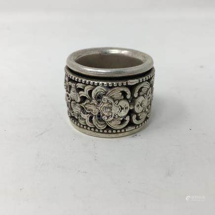 A Chinese white metal thumb ring with inner revolving ring.