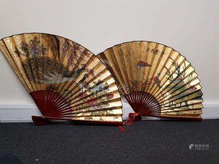 Two large contemporary Chinese fans.