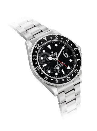 ROLEX.A STAINLESS STEELAUTOMATIC DUAL TIME WRISTWATCH WITH SWEEP CENTRE SECONDS, DATEAND BRACELET