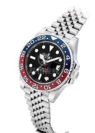 ROLEX.A STAINLESS STEELAUTOMATIC DUAL TIME WRISTWATCH WITH SWEEP CENTRE SECONDS, DATE, BRACELETAND CERAMIC BEZEL