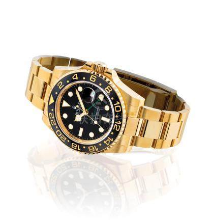 ROLEX.A FINE 18K GOLDAUTOMATIC DUAL TIME WRISTWATCH WITH SWEEP CENTRE SECONDS, DATEAND BRACELET