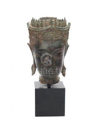 A bronze Buddha head, mounted on a base. Ayutthaya period (1361-1767), Thailand, 17/18th