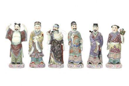 A set of six Chinese famille rose Daoist immortals, standing on clouds, holding various attributes.