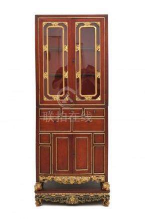 A Chinese elmwood display cabinet. With gilt carved ornaments. On a richly carved plinth. 20th
