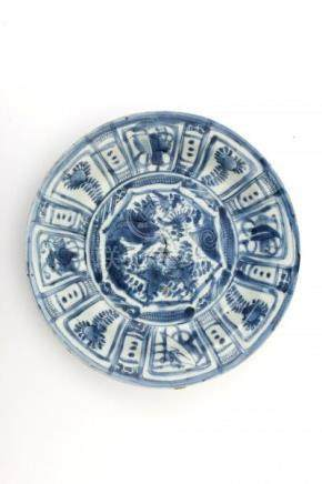 A Chinese blue and white 'kraak porselein' dish decorated with a star-shaped panel enclosing a bird