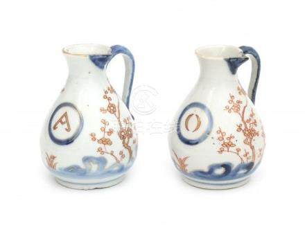 A Chinese export oil and vinegar jug, decorated in Imari style with cherry blossom. 18th century.