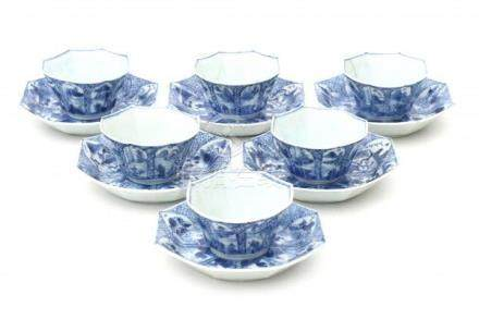 A set of six octagonal Chinese blue and white cup and saucers , decorated with landscapes in
