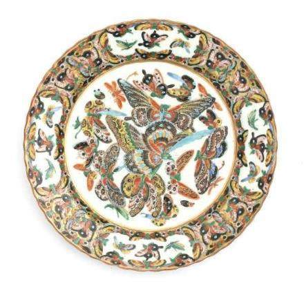 A set of four Canton famille rose export plates, decorated with butterflies. Marked with apocryphal