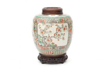 A Chinese famille verte lidded vase decorated with panels of antiquities and cherry blossom. With