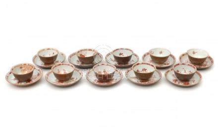 Ten Chinese export café-au-lait cups and saucers decorated in iron red in three decors. 18th