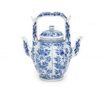 A Chinese blue and white wine ewer with two spouts and two compartiments. decorated with prunus.