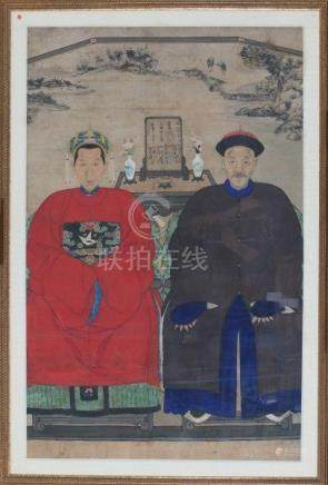 A framed Chinese ancestral portrait, with a man and a woman in official robes, in the background an