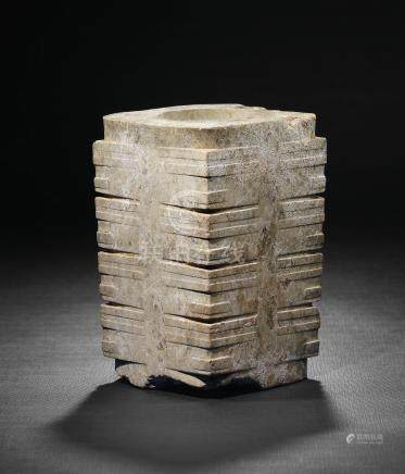 A RARE WHITE JADE FOUR-TIERED 'ANIMAL MASK' CONG