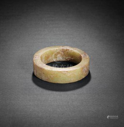 A YELLOW AND RUSSET JADE BRACELET, ZHUO