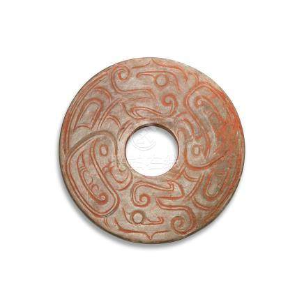 A CELADON JADE 'DRAGON' DISC, BI