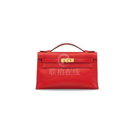 A ROUGE PIVOINE EPSOM LEATHER KELLY POCHETTE WITH GOLD HARDWARE