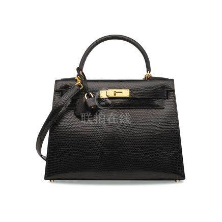 A SHINY BLACK NILOTICUS LIZARD SELLIER KELLY 28 WITH GOLD HARDWARE