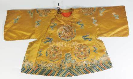 A Chinese Imperial Yellow Dragon Robe for a child. This would have been worn by a child of the