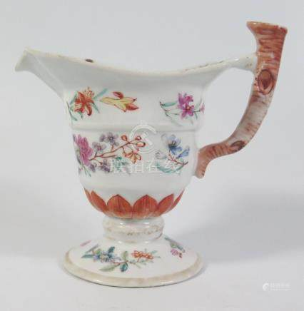 An 18th century Chinese Export Famile Rose Porcelain Helmet Shaped Cream Jug, 12cm high