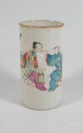 A 19th Century Chinese Famille Rose Porcelain Brush Pot decorated with a lady having her face