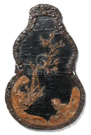A rare Imperial zitan and chenxiangmu lacquered 'double-gourd' panel 18th century
