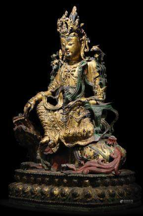 A rare and large parcel-gilt and painted bronze figure of Simhanada Avalokiteshvara 15th/16th century