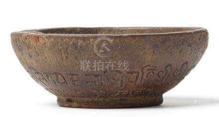 A rare small rhinoceros horn documentary 'vishnu' bowl Nepal, dated by inscription to 1678 and of the period