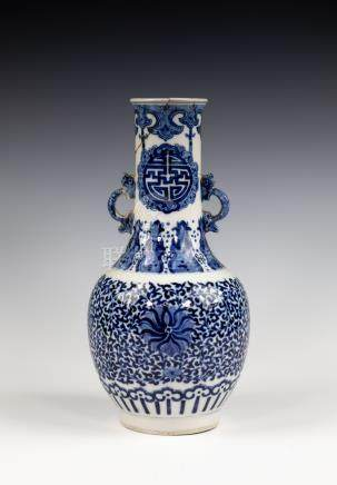 A Chinese porcelain blue and white twin handled vase, in the Kangxi style, probably 19th Century, of