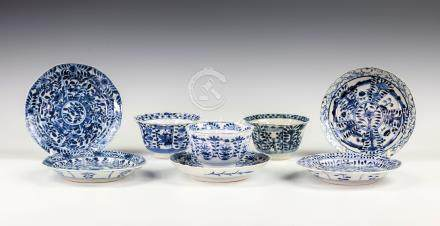 A Chinese porcelain blue and white tea bowl and saucer, Kangxi four character mark and of the period
