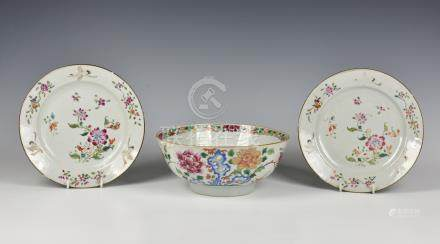 A Chinese porcelain famille rose punch bowl, late 18th century, enamelled with peonies issuing